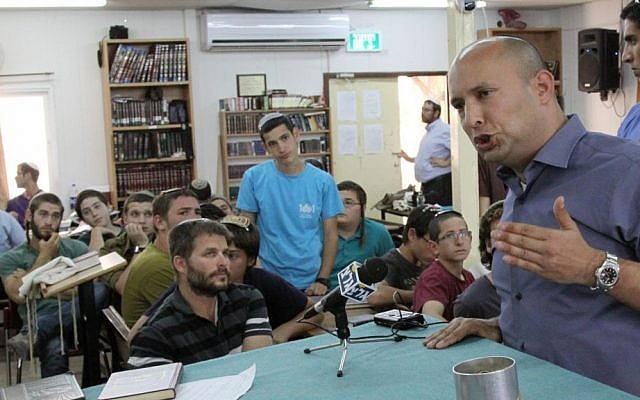 Naftali Bennett speaks to students at the Mekor Chaim yeshiva in Kibbutz Kfar Etzion, which two of the kidnapped teens attend, on June 16, 2014. (photo credit: Gershon Elinson/Flash90)