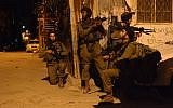Illustrative image of the IDF 931 Nachal Brigade seen during search patrols in Balata refugee camp near Nablus in the West Bank, on the night of June 16, 2014. (IDF Spokesperson/Flash90)
