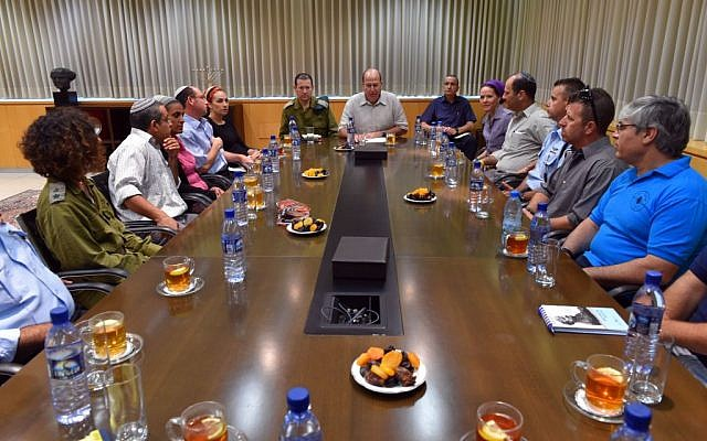 Defense Minister Moshe Ya'alon meets with the families of kidnapped Jewish teens Naftali Frankel, Gil-ad Shaar, and Eyal Yifrach, in Tel Aviv on Wednesday, June 18, 2014. (photo credit: Ariel Hermoni/Defense Ministry/Flash90)