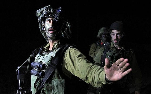 Illustrative photo of Israeli soldiers patrolling near Ramallah, on June 20, 2014. (photo credit: Issam Rimawi/Flash 90)