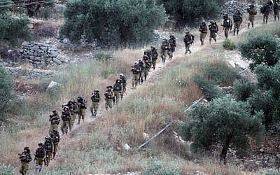 Israeli soldiers patrol the West Bank village of Aroura near Ramallah, early on June 20, 2014.  (photo credit: Issam Rimawi/Flash 90)