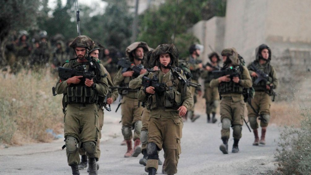 Israeli soldiers patrol near Ramallah on Friday, June 20, 2014 (Photo credit: Issam Rimawi/Flash 90)