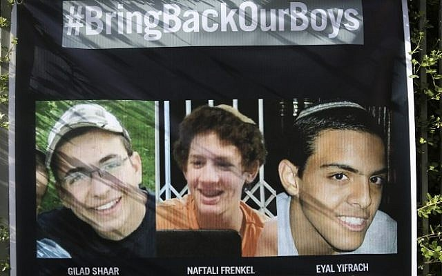 """A sign showing pictures of Gil-ad Shaar, Naftali Fraenkel, and Eyal Yifrach, saying """"Bring Back Our Boys"""" hangs outside a residence on Ramban street, Jerusalem, on June 20, 2014. (Photo credit: Hadas Parush/Flash90)"""