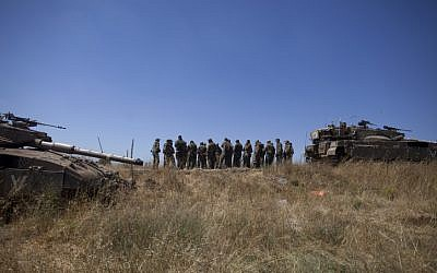 Israeli soldiers seen during patrol in the Golan Heights after a 15-year-old Israeli boy was killed in what the IDF said was a missile attack from Syria, June 22, 2014. (photo credit: Flash90)