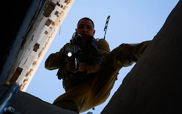 A soldier searches in the West Bank for three abducted Israeli teens, June 23, 2014. (Photo credit: IDF SPokesperson/Flash90)