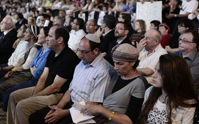 Parents of three abducted teens -- Eyal Yifrach, Gil-ad Shaar and Naftali Fraenkel -- attend a rally calling for their release, in Tel Aviv, Sunday, June 29, 2014. (Photo credit: Tomer Neuberg/Flash90)