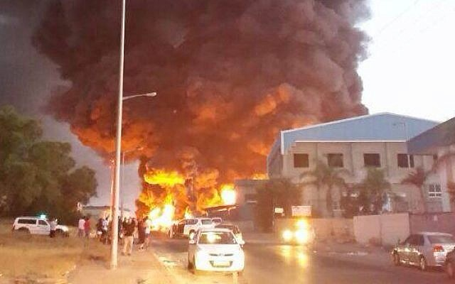A rocket fired from Gaza directly hit a factory in the industrial zone of the southern Israeli city of Sderot, causing it to catch on fire, Saturday evening, June 28, 2014. The fire led to further explosions inside the factory. (Photo credit: Edit Israel/Flash90)