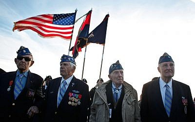 From left, World War II veterans of the U.S. 29th Infantry Division, Hal Baumgarter, 90 from Pennsylvania, Steve Melnikoff, 94, from Rhode Island, Don McCarthy, 90 from Maryland, and Morley Piper, 90, from Massachusetts, attend a D-Day commemoration, on Omaha Beach, western France , Friday June 6, 2014. (photo credit: AP/Thibault Camus)