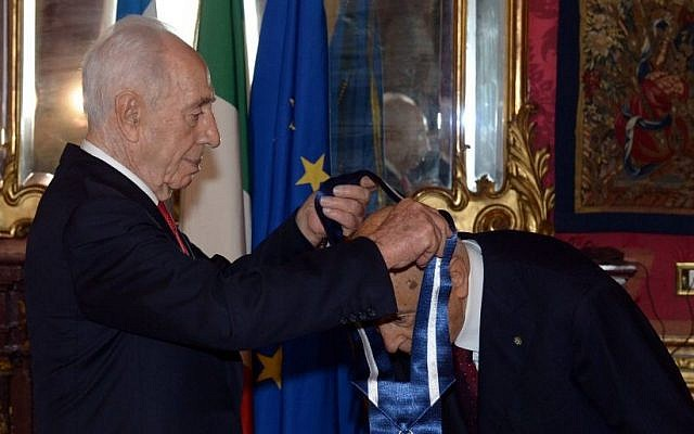 President Shimon Peres places the Presidential Medal of Distinction around the neck of Italian President Giorgio Napolitano (photo credit: Haim Tzach/GPO)