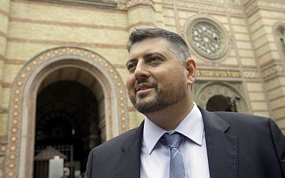 In this picture taken Friday May 30 2014, Csanad Szegedi stands in front of a Budapest Synagogue. (photo credit: AP Photo/Peter Kohalmi)