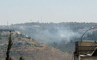 Two firefighting planes making repeated runs over a large blaze in a forest in southern Jerusalem. (photo credit: Times of Israel/Stuart Winer)