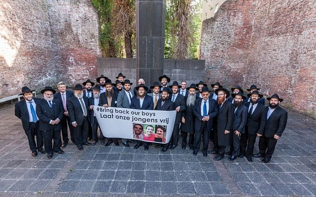 Rabbis from the Rabbinical Center of Europe gather in Amsterdam to show support for the release of three Israeli teenagers kidnapped in the West Bank, June 18, 2014. (photo credit: Rabbinical Center of Europe)
