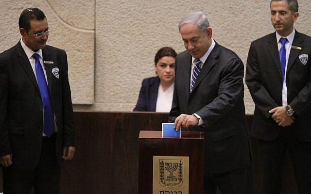 Prime Minister Benjamin Netanyahu casts his ballot for Israel's next president, in the Knesset, Tuesday, June 10, 2014 (photo credit: Knesset spokesman)