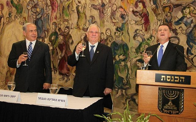 From left to right, Prime Minister Benjamin Netanyahu, President-elect Reuven Rivlin and Knesset Speaker Yuli Edelstein raise a toast after Rivlin is elected to the presidency Tuesday. (photo credit: Knesset Spokesperson)