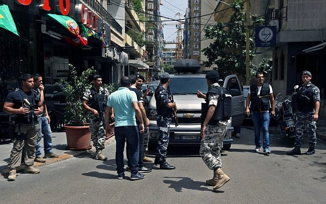 Lebanese police intelligence gather outside a hotel in Hamra street in Beirut, Lebanon, June 20, 2014  (photo credit: AP/Bilal Hussein, File)