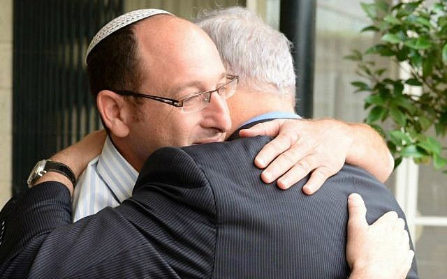 Prime Minister Benjamin Netanyahu embracing Ophir Shaar, father of kidnapped Israeli teen Gilad Shaar, Friday, June 20, 2014, at the Prime Minister's Residence in Jerusalem. (Photo credit: GPO/Kobi Gideon)
