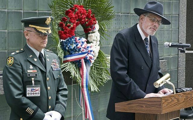Rabbi Berkowitz giving opening prayers for Veteran's Memorial Service at the Vietnam Memorial in lower Manhattan in 2011. Lt. Col. Dwight Webster (Ret) from MTA Bus Maintenance Services stands to his right. (Photo credit: Metropolitan Transportation Authority/Patrick Cashin)