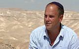 Dr. Micah Goodman on the grounds of his Ein Prat Midrasha in Alon. (YouTube screenshot)