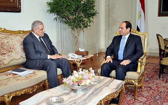 This photo released by Egypt's official Middle East News Agency (MENA) shows Prime Minister Ibrahim Mehleb, left, meeting with President Abdel-Fattah el-Sissi at the presidential palace in Cairo, Egypt, Thursday, June 12, 2014. (photo credit: AP/MENA)