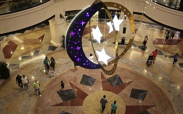 People walk inside a shopping mall with Ramadan decorations as they prepare for the holy month of Ramadan starting tomorrow in Dubai, United Arab Emirates, Saturday, June 28, 2014. (photo credit: AP /Kamran Jebreili)