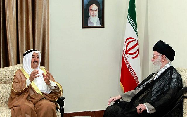 In this picture released by an official website of the office of the Iranian supreme leader, Supreme Leader Ayatollah Ali Khamenei, right, listens to Kuwait's Emir Sheik Sabah Al Ahmad Al Sabah, during their meeting in Tehran, Iran, Tuesday, June 2, 2014 (photo credit: AP Photo/Office of the Iranian Supreme Leader)