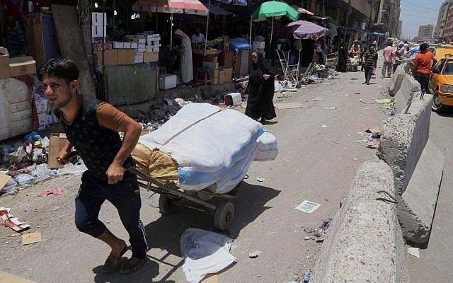 In this photo taken on June 17, 2014, people shop around at a market in Baghdad, Iraq. (photo credit: AP Photo/Karim Kadim)