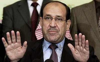 Then-Iraqi prime minister Nouri al-Maliki speaks to the press in Baghdad, Iraq, March 2010. (AP Photo/Hadi Mizban)