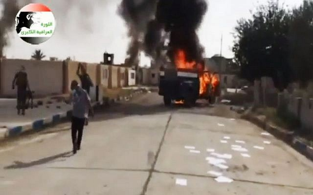 This image made from video posted by Iraqi0Revolution, a group supporting the al-Qaeda breakaway Islamic State of Iraq and the Levant (ISIL) on Wednesday, June 11, 2014, shows an attack on a base north of Tikrit, Iraq. (photo credit: AP Photo/Iraqi0Revolution via AP video)