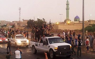 Islamic State fighters parade in the northern city of Mosul, Iraq, on ,June 25, 2014 (photo credit: AP)