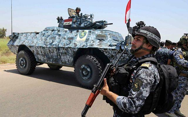 Iraqi federal policemen patrol in Baghdad's Abu Ghraib suburb, Iraq, Saturday, June 28, 2014. Iraqi troops launched an operation this week to push back Islamic State advances in Anbar province. (AP Photo/Karim Kadim)
