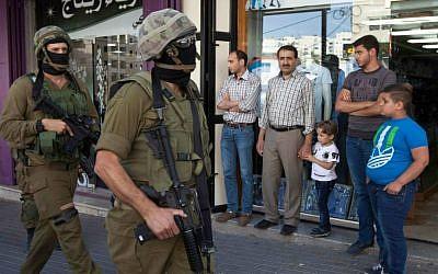 Illustrative photo of IDF soldiers, June 19, 2014 (AP Photo/Majdi Mohammed)