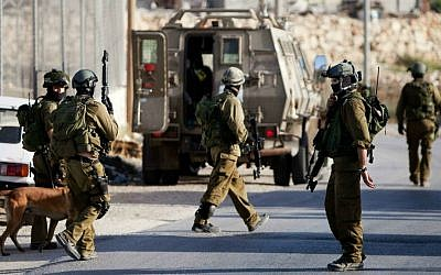 Illustrative photo of the IDF in the West Bank. June 19, 2014. (photo credit: AP/Majdi Mohammed)