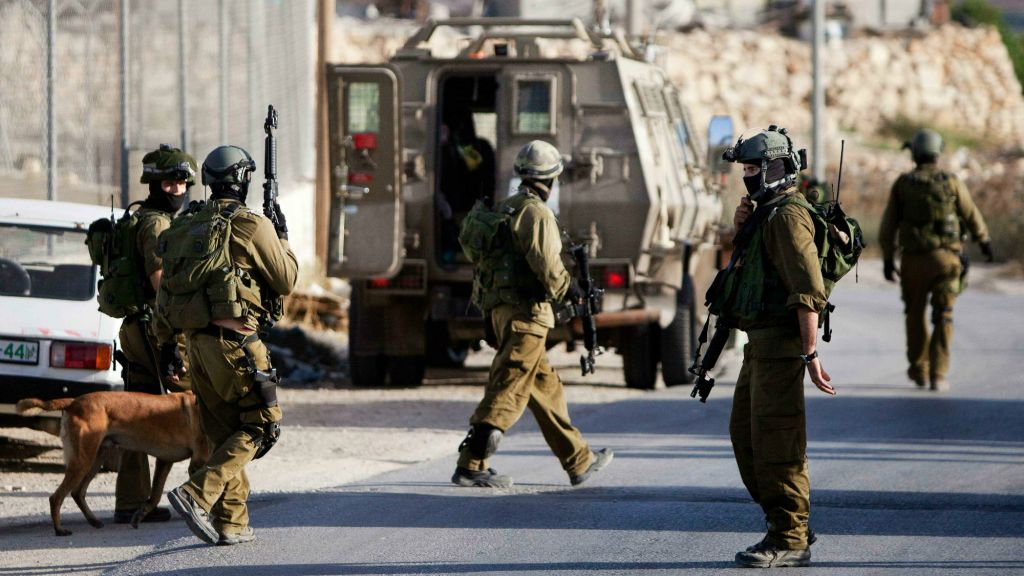 IDF soldiers search for three missing teens believed to have been abducted in the West Bank city of Hebron, Thursday, June 19, 2014. (AP Photo/Majdi Mohammed)