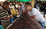 A Palestinian vendor sells dates for Ramadan at a market in Jenin, June 28, 2014. (photo credit: AP/Mohammed Ballas)