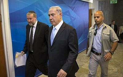 Prime Minister Benjamin Netanyahu arrives to the weekly cabinet meeting at his office in Jerusalem, Sunday, June 22, 2014. (Photo credit: AP/Baz Ratner, Pool)