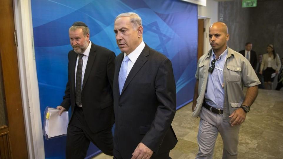 Prime Minister Benjamin Netanyahu arrives to the weekly cabinet meeting at his office in Jerusalem, Sunday, June 22, 2014. (Photo credit: AP/Baz Ratner, Pool)