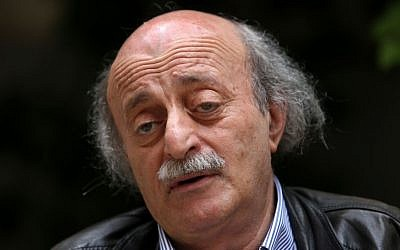 Walid Jumblatt, the political leader of Lebanon's minority Druse sect, speaks during an interview with The Associated Press, as he sits in his garden house, in Beirut, Lebanon, on May 28, 2014. (photo credit: AP Photo/Hussein Malla)
