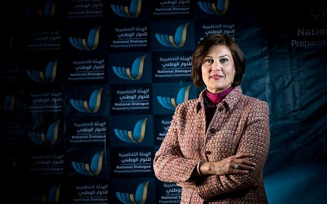 In this March 2014 image released by the National Dialogue Preparatory Commission, Salwa Bugaighis, lawyer and rights activist, poses for a photograph during a meeting in Tripoli, Libya. One of Libya's most prominent female activists was assassinated in the restive eastern city of Benghazi when gunmen stormed her house, the state news agency reported Thursday, in slaying that stunned human rights advocates. Bugaighis, was at the forefront in the 2011 uprising against dictator Moammar Gadhafi. She was among the most outspoken voices against militiamen and Islamic extremists who have run rampant in the country since Gadhafi's fall. (photo credit: AP Photo/National Dialogue Preparatory Commission)