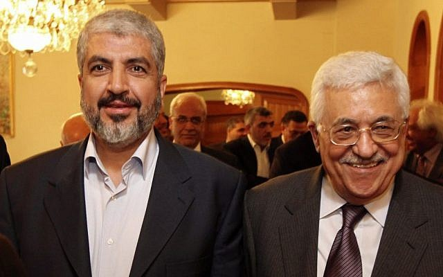 Palestinian Hamas leader Khaled Mashaal, left, and Palestinian Authority President Mahmoud Abbas during their meeting in Cairo, Egypt, November 2011 (photo credit: AP/Office of Khaled Mashaal)