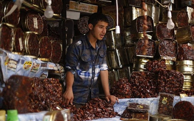 A Yemeni vendor displays a variety of dates, traditionally eaten after breaking the fast, on the first day of the Muslim holy month of Ramadan in a market in the Old City of Sanaa, Yemen, Saturday, June 28, 2014. (photo credit: AP/Hani Mohammed)