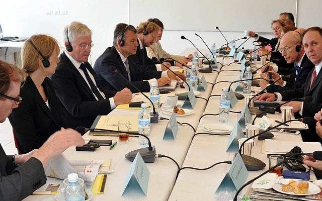 Claims Conference representatives meet with German officials during Holocaust restitution negotiations in Israel in 2013. (photo credit: Courtesy Claims Conference)