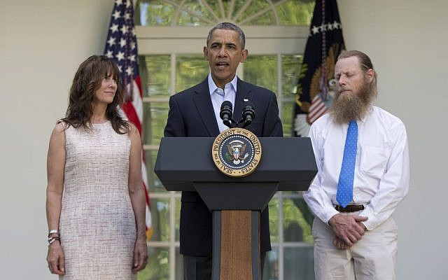 President Barack Obama speaks with Jani Bergdahl, left, and Bob Bergdahl, right, the parents of US Army Sgt. Bowe Bergdahl, in the Rose Garden of the White House in Washington, Saturday, May 31, 2014, after the announcement that Bowe Bergdahl has been released from captivity. (photo credit: AP/Carolyn Kaster)