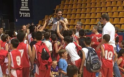 Youngsters throng Pau Gasol at his Jerusalem basketball clinic, June 1, 2014 (photo credit: Raphael Gellar)