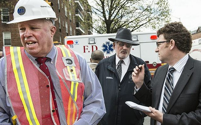 Rabbi Harry Berkowitz (center) with MTA Chairman and CEO Tom Prendergast (left) and Adam Lisberg, head spokesman of the MTA (right) at  the site of a subway derailment on Friday, May 2, 2014 in Queens, New York.(Photo credit: Metropolitan Transportation Authority/Patrick Cashin)