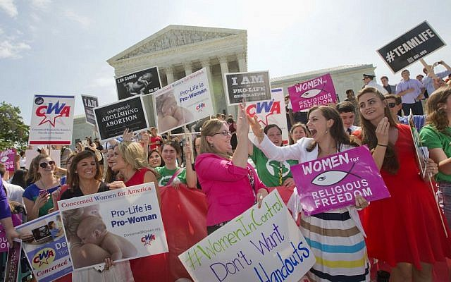 Demonstrators react to hearing the Supreme Court's decision on the Hobby Lobby case outside the Supreme Court in Washington, Monday, June 30, 2014. (photo credit: AP Photo/Pablo Martinez Monsivais)