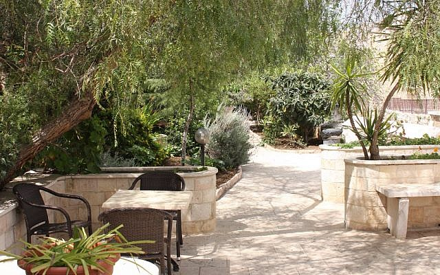 The tranquil garden of the Lutheran Hotel (photo credit: Shmuel Bar-Am)
