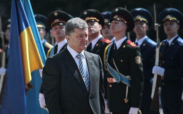 Ukrainian President Petro Poroshenko reviews an honor guard after the inauguration ceremony in Sophia Square in Kiev, Ukraine, Saturday, June 6, 2014. (photo credit: AP/Sergei Chuzavkov)