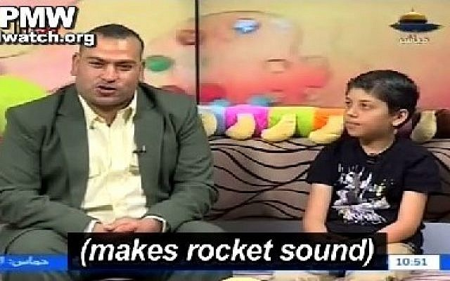 A guest on  a children's show aired on Hamas's Al-Aqsa TV imitates the sound of a rocket being launched at Israel. (screen capture, Palestinian Media Watch)
