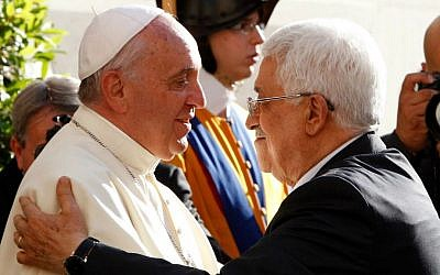 Pope Francis welcomes Palestinian Authority President Mahmoud Abbas, right, as he arrives at the Vatican, Sunday, June 8, 2014. (AP Photo/Riccardo De Luca, Pool)
