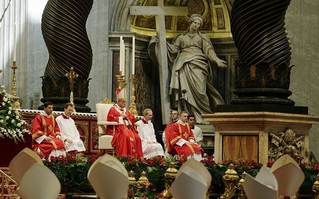 Pope Francis, background center, celebrates a mass of Pentecost in St. Peter's Basilica, at the Vatican, June 8, 2014. (photo credit: AP/Gregorio Borgia)